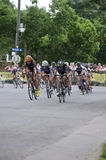 Cyclists Race for Lead at Uptown Royalty Free Stock Photography