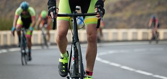 Cyclists with racing bikes during the cycling road race stock images