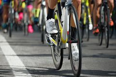 Cyclists with racing bikes during the cycling road race. Cycling competition,cyclist athletes riding a race,detail cycling shoes Royalty Free Stock Photos