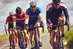 Cyclists racing on country roads. On a sunny day in the UK stock photo