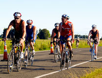 Cyclists racing in half ironman event. Stock Photos