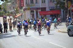 Cyclists racing on Varna street. Cycling peloton passing on Varna city street -participants in the first International Cycling Tour of Bulgarian Black Sea Coast Stock Photo