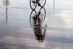 Cyclists in the rain Royalty Free Stock Photos