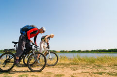 Cyclists relax biking outdoors. Two cyclists relax biking outdoors royalty free stock photos