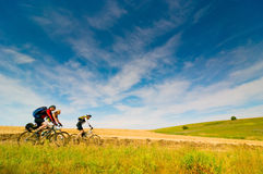 Cyclists relax biking outdoors. Mixed group of cyclists outdoors royalty free stock photo