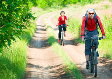 Cyclists relax biking outdoors. Two cyclists relax biking outdoors royalty free stock photo