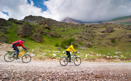 Cyclists relax biking outdoors. Two cyclists relax biking outdoors stock image
