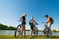 Cyclists relax biking outdoors. Mixed group of cyclists at sunrise stock photo