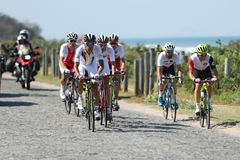 Cyclists ride during Rio 2016 Olympic Cycling Road competition of the Rio 2016 Olympic Games Stock Photo