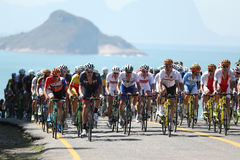 Cyclists ride during Rio 2016 Olympic Cycling Road competition of the Rio 2016 Olympic Games in Rio de Janeiro Royalty Free Stock Photo
