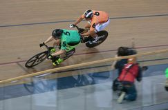 Sixday cycling series finals in palma velodrome. Cyclists ride during their final race at the Sixday cycling event finals in Palmaarena velodrome in the Spanish royalty free stock photo