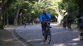 Cyclists ride in Vondelpark stock video