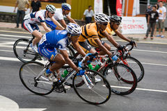 Cyclists riding abreast in the race. This is the seventh stage of the international bicycle race, le Tour de Langkawi held in city of Kuala Lumpur, Malaysia. The Royalty Free Stock Images