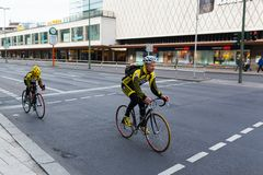Cyclists riding bicycles on street Stock Photography