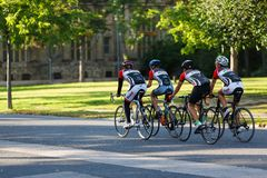 Cyclists riding bicycles on street Stock Photo