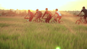 Cyclists riding bicycles stock video footage