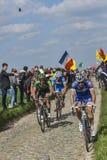 Cyclists Riding Paris-Roubaix 2014. Carrefour de l'Arbre,France-April 13,2014: A group of cyclists including Arnaud Demare -FDJ Team and Yannick Martinez Stock Images