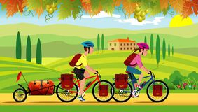 Cyclists riding through Tuscany in September stock photography