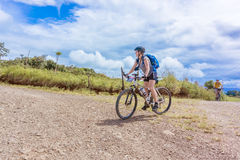 Cyclists on the road in Costa Rica near Tierras Morenas. Royalty Free Stock Image