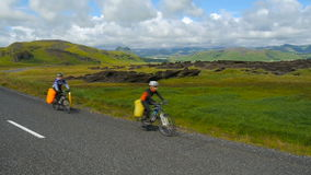 Cyclists on the road in Iceland stock video footage