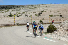 Cyclists on road to top of Ventoux mount Royalty Free Stock Photo