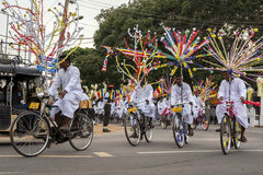 Cyclists set off during the Full Moon Perahera in Jaffna, Sri Lanka Stock Images