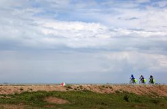 Cyclists on the shores of qinghai lake royalty free stock photos