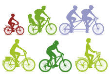 Cyclists in silhouette. Illustrations of cyclists in silhouette including men, women, children, an adult with child in rear seat and adults riding a tandem Royalty Free Stock Photo