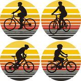 Cyclists silhouettes on the background. Cyclists on the move in the background of sunset sky Royalty Free Stock Image