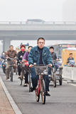 Cyclists in smog blanketed city, Beijing, China Royalty Free Stock Photo