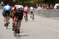 Cyclists Sprint Down Street In Duluth Criterium Event Royalty Free Stock Images