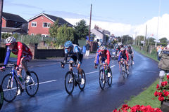 Cyclists stage 4 of the tour of Britain race 2012. Some of the riders in the Tour of Britain cycle race as it passes through Pilling in Lancashire on stage 4 Stock Images