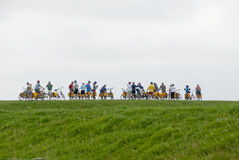 Cyclists on Terschelling. Group of cyclists on an organized tour in the Netherlands, island of Terschelling Stock Photo