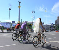 Cyclists. Three cyclist cycling on lyubitelskoy in Kiev. guys and groom royalty free stock images