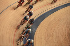 Cyclists to ride fast in a curve close-up Stock Photos