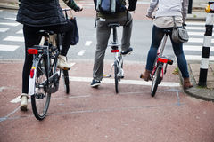 Cyclists at the traffic lights Stock Images