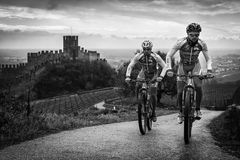 Cyclists train on the hills surrounding the castle of Soave. Royalty Free Stock Photo