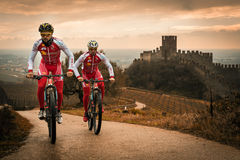 Cyclists train on the hills surrounding the castle of Soave. Stock Images