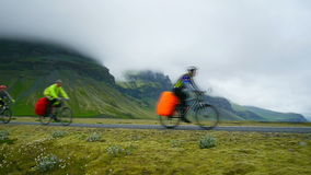 Cyclists travel the roads of Iceland