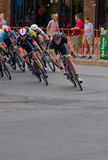 Cyclists Turn Corner at Uptown Criterium Stock Photo