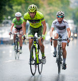 Cyclists from various teams cycle Stock Photos