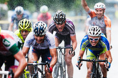 Cyclists from various teams cycle Royalty Free Stock Image