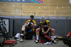Sixday cycling series finals in palma velodrome riders before race. Cyclists wait for the the start of their final race at the Sixday cycling event finals in stock photography