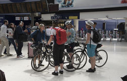 Cyclists waiting for a train Royalty Free Stock Photos