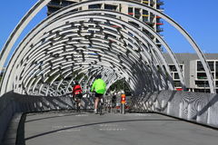 Cyclists Modern architecture Stock Images