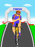 Cyclists winner biking road bicycle across the finish line Stock Photos