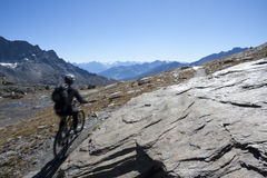 Cyclits in the mountain trail. Cyclists on a mountain trail in the Alps Royalty Free Stock Images