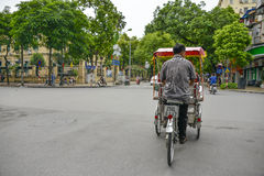 Cyclo driver in Hanoi, Vietnam Royalty Free Stock Images