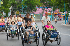 Cyclo drivers carry tourists Stock Photo