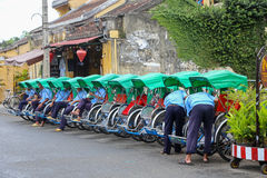 Cyclo drivers waiting for fares in the old town of Hoi An Royalty Free Stock Photos